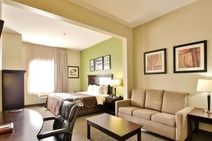 A seating area at Sleep Inn & Suites University