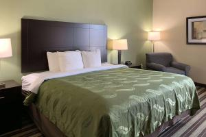 A bed or beds in a room at Quality Inn & Suites West Monroe