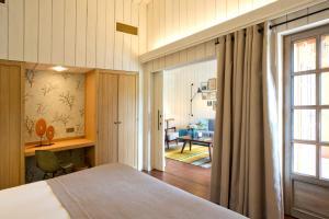 Un ou plusieurs lits dans un hébergement de l'établissement Les Sources de Caudalie