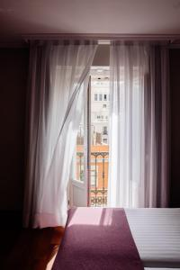 A bed or beds in a room at Hotel Infantas by MIJ