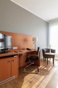 A kitchen or kitchenette at Hotel Park Consul Köln