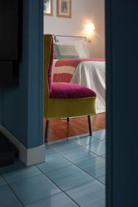 A bed or beds in a room at B&B Attico Partenopeo