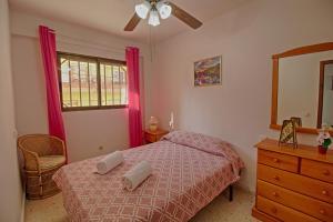 Cama o camas de una habitación en Holiday Apartment Levante Beach