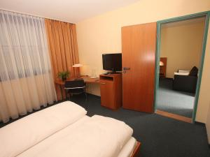 A television and/or entertainment center at Transmar Travel Hotel