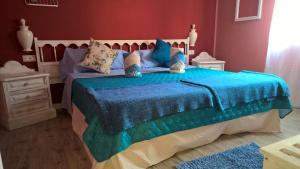 Letto o letti in una camera di Casa Regina Tenerife
