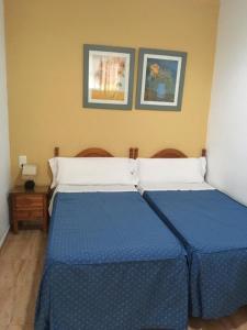 Cama o camas de una habitación en Hostal Fantoni