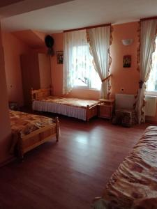 A bed or beds in a room at Hadjibulevata Guest House