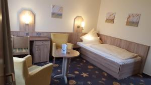 Ein Bett oder Betten in einem Zimmer der Unterkunft Hotel Seeterrassen