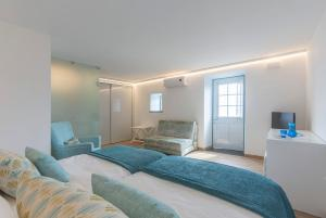 Uma cama ou camas num quarto em Abrigo da Cascata - Casas de Campo - São Jorge