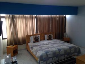 Кровать или кровати в номере LT Aparthotel