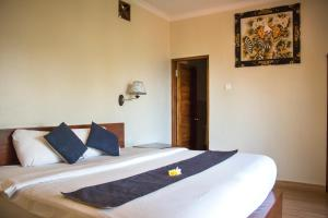 A bed or beds in a room at Bali Rahayu Homestay