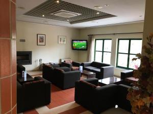 A seating area at Viseu Garden Hotel
