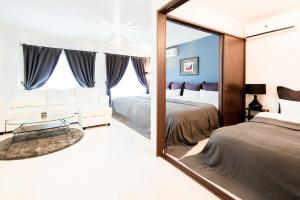A bed or beds in a room at Beauty Villa Tengachaya 301