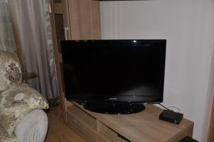 A television and/or entertainment center at Victoria Sun appartments