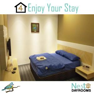 A bed or beds in a room at NEST Dayrooms