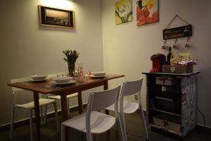A restaurant or other place to eat at Portarotese apartment with terrace