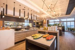 A restaurant or other place to eat at Belaire Suites Hotel