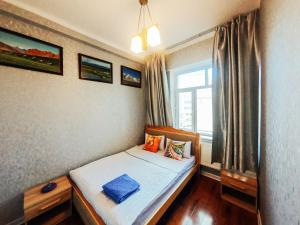 A bed or beds in a room at Top Tour & Guesthouse Mongolia