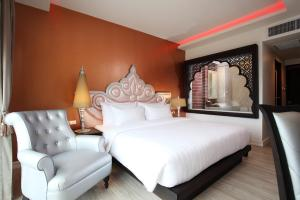 A bed or beds in a room at Chillax Resort