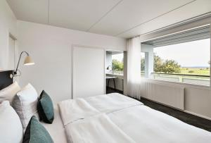 En eller flere senge i et værelse på Comwell Køge Strand