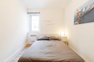 A bed or beds in a room at Maison de ville pour 4 personnes
