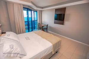 Cama ou camas em um quarto em Hotel Bhally