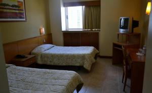 A bed or beds in a room at Hotel Coliseo