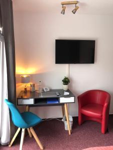 Телевизор и/или развлекательный центр в Hotel Annablick