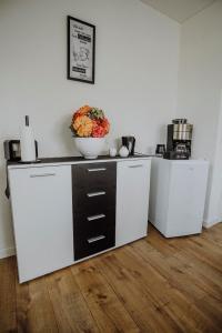 A kitchen or kitchenette at B&B Pieper-Werning
