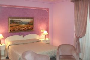 A bed or beds in a room at Hotel La Torre