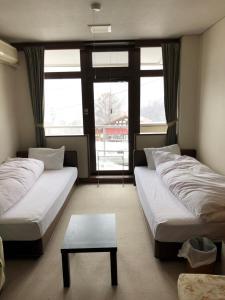 飛騨高山温泉 ジョイフル朴の木にあるベッド