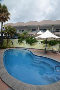 The swimming pool at or near Rockpool Motor Inn