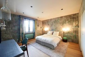 Un ou plusieurs lits dans un hébergement de l'établissement Hotel Groenendaal