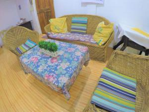 A bed or beds in a room at Qadlao Homestay
