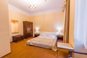 Cama o camas de una habitación en Hotel Garden Palace