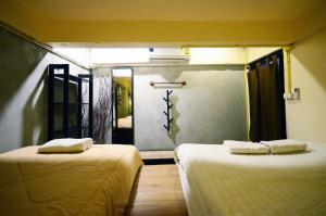 A bed or beds in a room at Buff Hostel