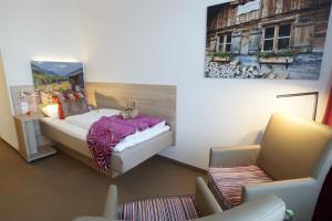 A bed or beds in a room at Hotel Edel Weiss