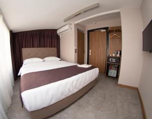 Letto o letti in una camera di Jurnal Hotel