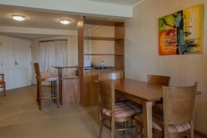 A kitchen or kitchenette at Marcin Hotel