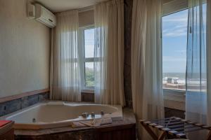 A bathroom at Marcin Hotel