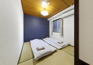 A bed or beds in a room at Osaka - Hotel / Vacation STAY 23784
