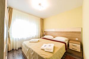 Un pat sau paturi într-o cameră la Apartament Carol Davila