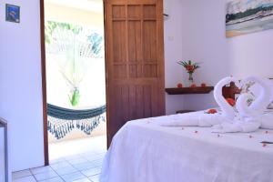 A bed or beds in a room at Pousada Lua Cheia