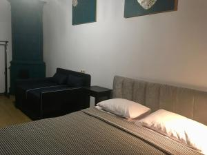 A bed or beds in a room at 4Rooms Hostel