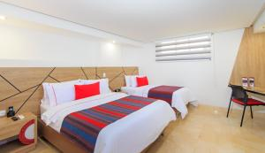 A bed or beds in a room at Obo Hotel
