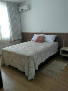 A bed or beds in a room at Conforto e vista privilegiada - Francisco Beltrão