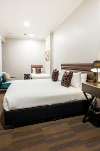 A bed or beds in a room at 57Hotel