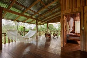 A seating area at Finca Amistad Cacao Lodge