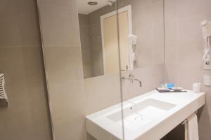 A bathroom at Art Hotel Museo