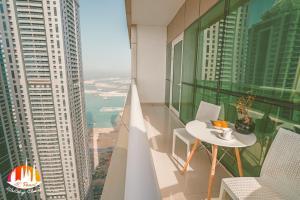 A balcony or terrace at AC Pearl Holiday- Marina View Three Bedroom Apartment